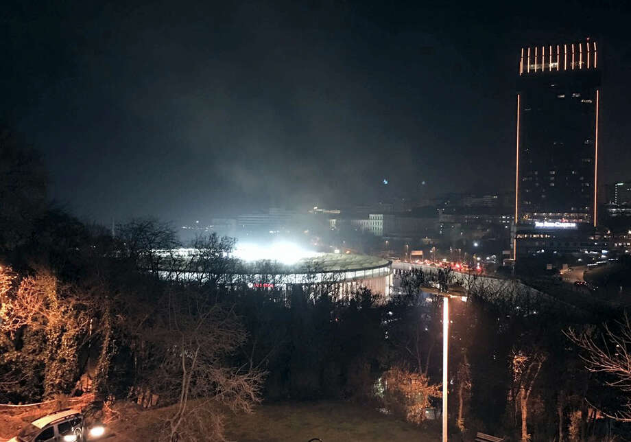 A view of Besiktas football club stadium, following at attack in Istanbul, late Saturday, Dec. 10, 2016. Two loud explosions have been heard near the newly built soccer stadium and witnesses at the scene said gunfire could be heard in what appeared to have been an armed attack on police. (AP Photo) TURKEY OUT Photo: AP / Copyright 2016 The Associated Press. All rights reserved.