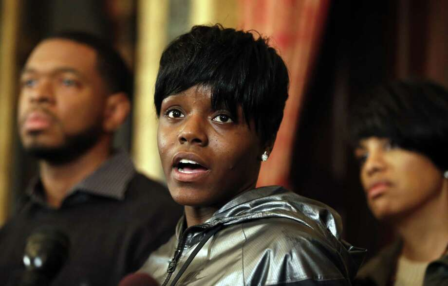 Fredricka Gray, center, the twin sister of Freddie Gray, speaks during a media availability at City Hall, after violence occurred after a march for Freddie Gray, Saturday, April 25, 2015 in Baltimore. Gray died from spinal injuries about a week after he was arrested and transported in a police van. (AP Photo/Alex Brandon) Photo: AP / AP