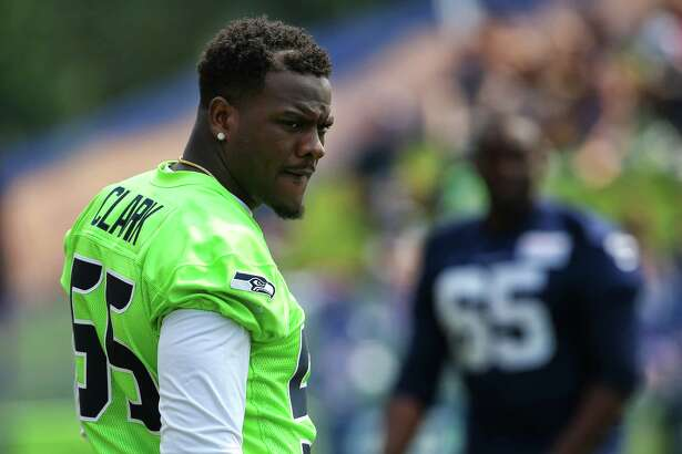 Defensive end Frank Clark is present before a scrimmage during Seahawks training camp, Monday, Aug. 7, 2017. He did not scrimmage with the team after provoking a fight at a practice last week.
