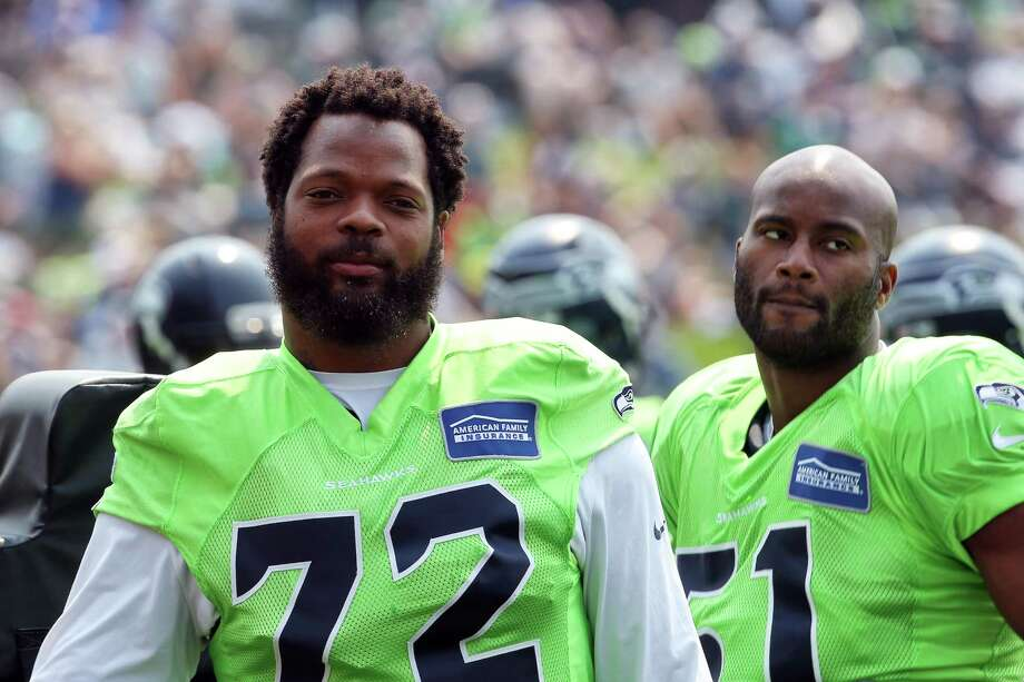 Michael Bennett (72) and Mike Morgan  (51) warm up before a scrimmage during Seahawks training camp, Monday, Aug. 7, 2017. Photo: GENNA MARTIN, SEATTLEPI.COM / SEATTLEPI.COM