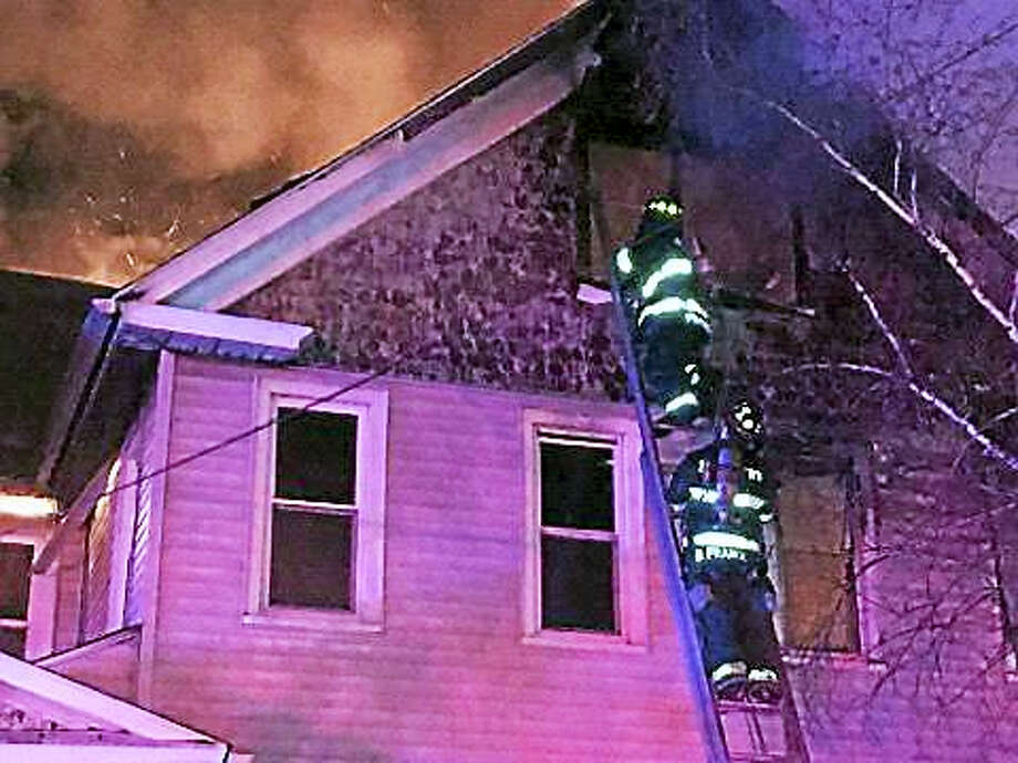 Courtesy photo  14 Glover Place in Middletown's North End was the scene of a blaze shortly after midnight on Sunday. Photo: Digital First Media