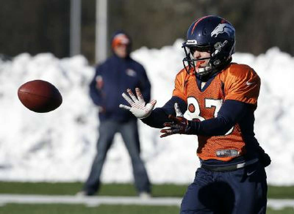 Denver Broncos wide receiver Wes Welker wears a special, larger helmet as extra protection to guard against concussions.