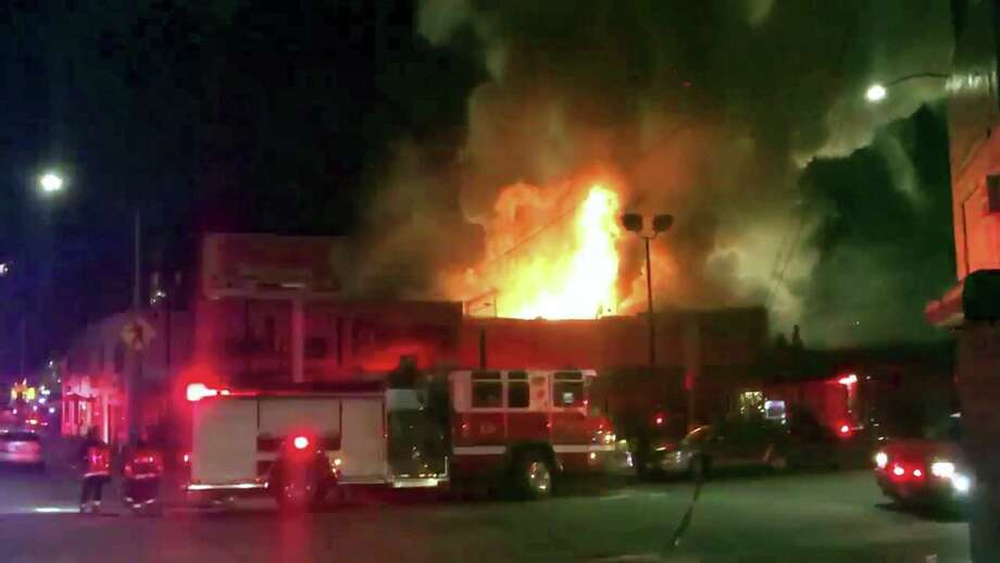 This photo taken from video provided by @Oaklandfirelive shows the scene of a fire in Oakland, early Saturday, Dec. 3, 2016.   The blaze began at about 11:30 p.m. on Friday during a party at a warehouse in the San Francisco Bay Area city.  Several people were unaccounted for.   Oakland Fire Department posted several messages throughout the night on its Twitter social media network account, including the latest one in the morning saying that fire crews would remain on the scene for several more hours to extinguish hot spots(@Oaklandfirelive via AP) Photo: AP / @Oaklandfirelive