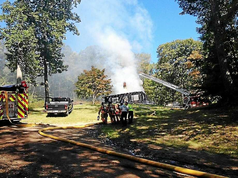 (Cassandra Day -- Middletown Press) Firefighters were on the scene of a house fire involving a propane tank explosion at a home on Ola Avenue, near Lake Pocotopaug. Photo: Journal Register Co.