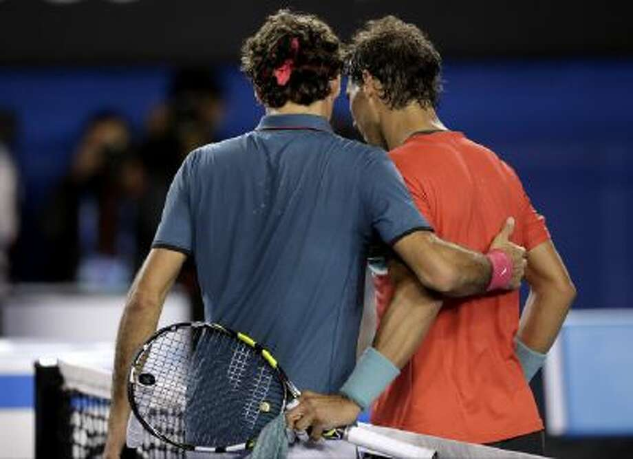 Rafael Nadal is congratulated by Roger Federer after Nadal's win.