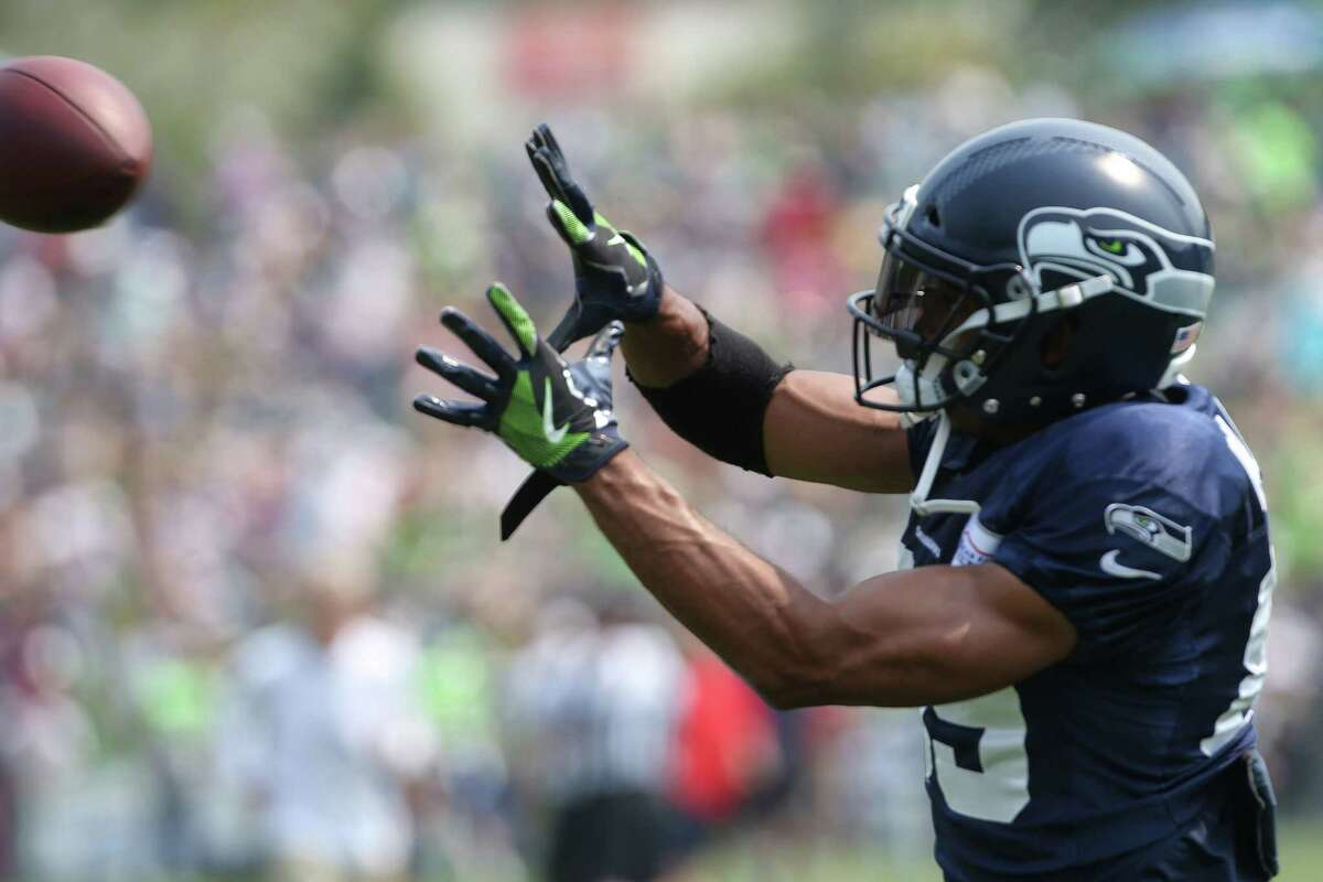 Doug Baldwin warms up before a scrimmage during Seahawks training camp, Monday, Aug. 7, 2017.
