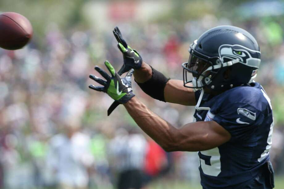 Doug Baldwin warms up before a scrimmage during Seahawks training camp, Monday, Aug. 7, 2017. Photo: GENNA MARTIN, SEATTLEPI.COM / SEATTLEPI.COM