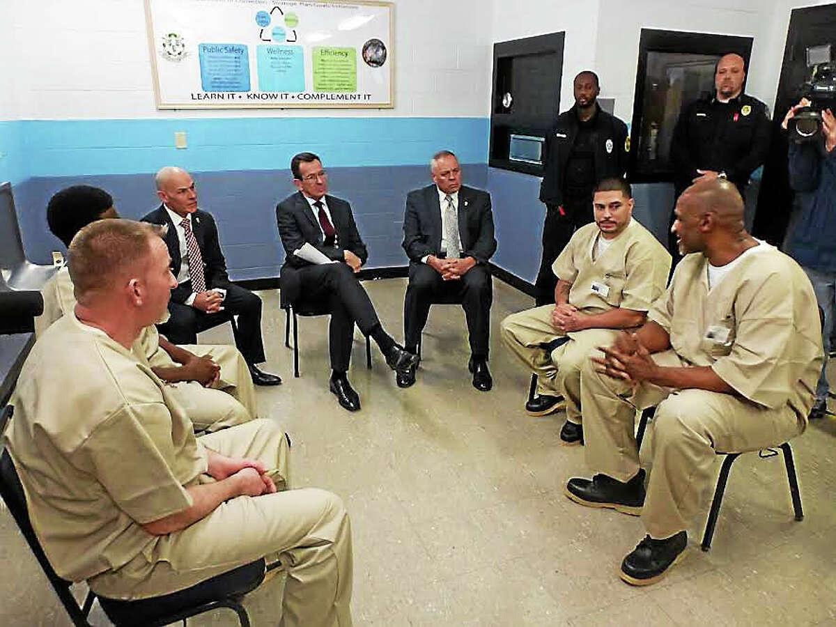 Warden Jose Feliciano, Gov. Dannel P. Malloy and Commissioner Scott Semple speak with inmates Scott Buckingham, Bradley Demoliere, Rafael Santiago and Bobby Ross.Ryan Flynn - New Haven Register