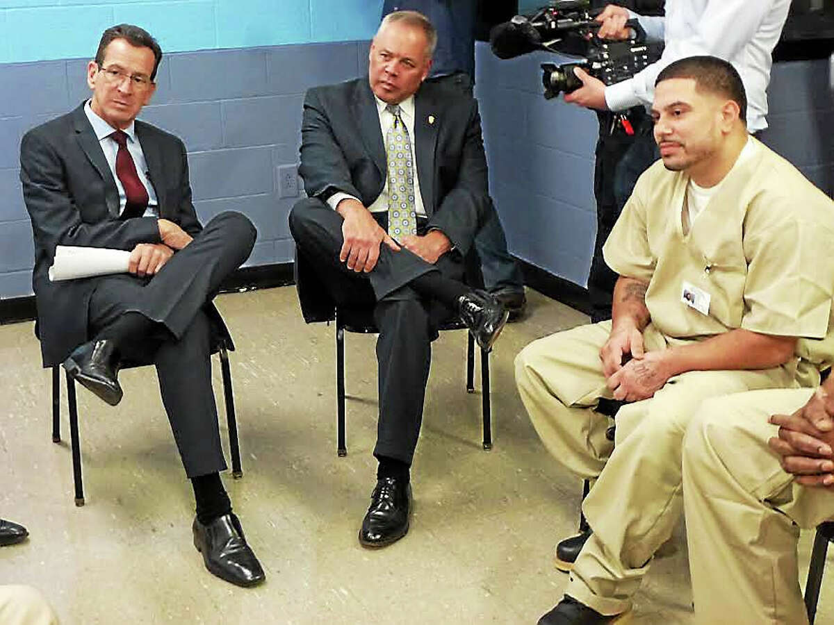 From left, Gov. Dannel P. Malloy, Commissioner Scott Semple and inmate Rafael Santiago discuss difficulties facing convicts who re-enter society.Ryan Flynn - New Haven Register