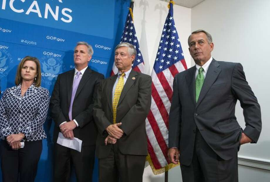 House Speaker John Boehner of Ohio, right, and House GOP leaders, participate in a news conference on Capitol Hill in Washington, Thursday, Sept. 26, 2013, as pressure builds over legislation to prevent a partial government shutdown. From left are, Rep. Lynn Jenkins, R-Kansas, House Majority Whip Kevin McCarthy of Calif., House Energy and Commerce Committee Chairman Rep. Fred Upton, R-Mich. and Boehner. (AP Photo/J. Scott Applewhite) Photo: AP / AP
