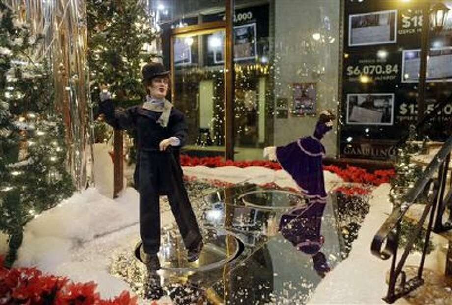 In this Nov. 21, 2013, photo, animated ice skaters perform in a window of the old Higbee's department store in Cleveland. Photo: AP / AP