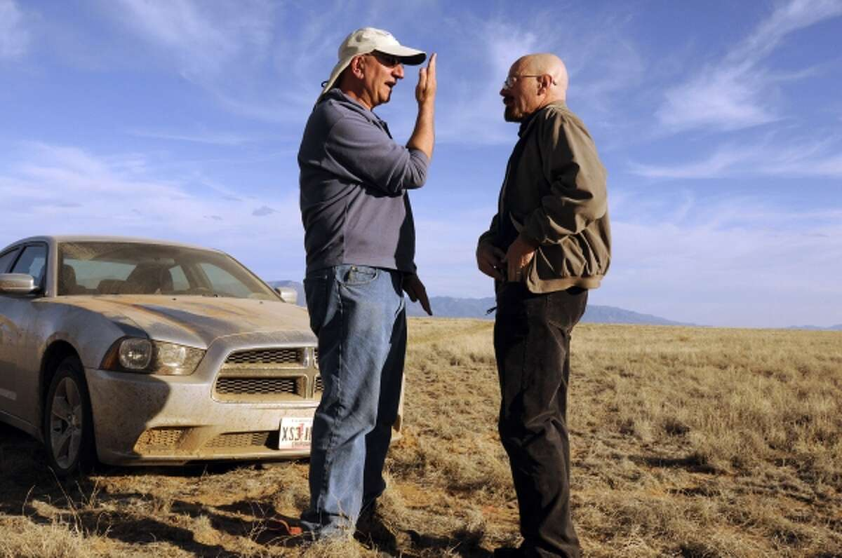 """This 2012 photo released by AMC shows cinematographer Michael Slovis, left, and Bryan Cranston on the set of """"Breaking Bad."""" The series finale will air on Sunday, Sept. 29. (AP Photo/AMC, Ursula Coyote)"""