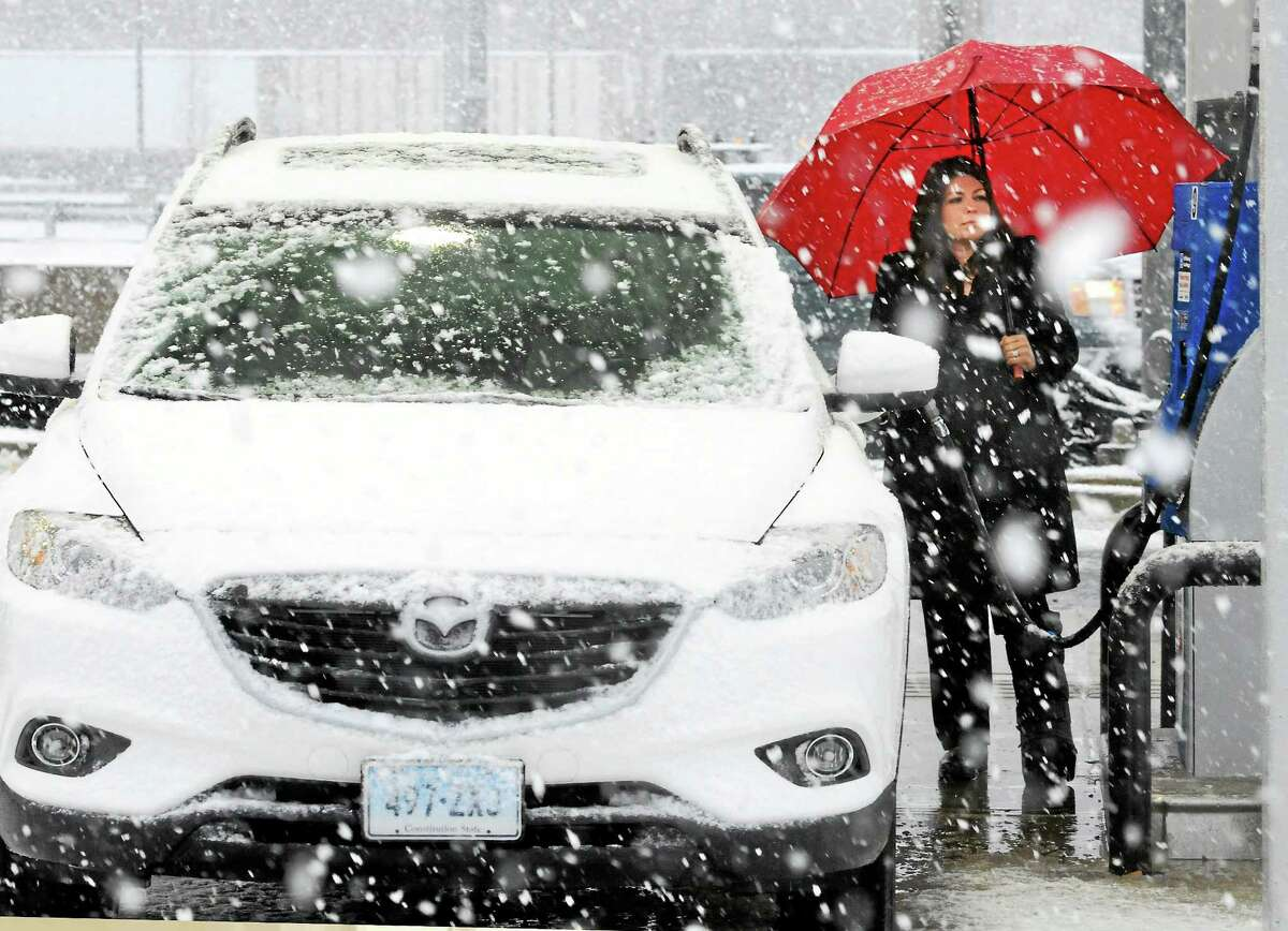 (Mara Lavitt - New Haven Register) A band of snow crossed the greater New Haven area during rush hour on Monday. Christal Esposito of North Branford stopped at the I-95 southbound Branford rest stop for gas on the way to bringing her children to school in New Haven and thought about returning home.