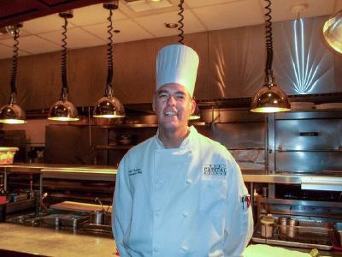 In this undated photo provided by The Capital Grille, chef Jeff Ansorge poses for a photo at the grill in Minneapolis. Ansorge, who used to command a staff of 17 at the posh downtown Minneapolis restaurant making nearly $80,000 a year, gave it all up to become the cook in charge of a Salvation Army soup kitchen where the meals are free and he makes a third of his previous salary.