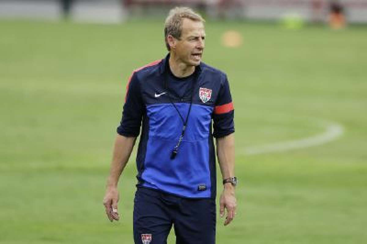 U.S. coach Jurgen Klinsmann works with his team in a training session in Brazil.