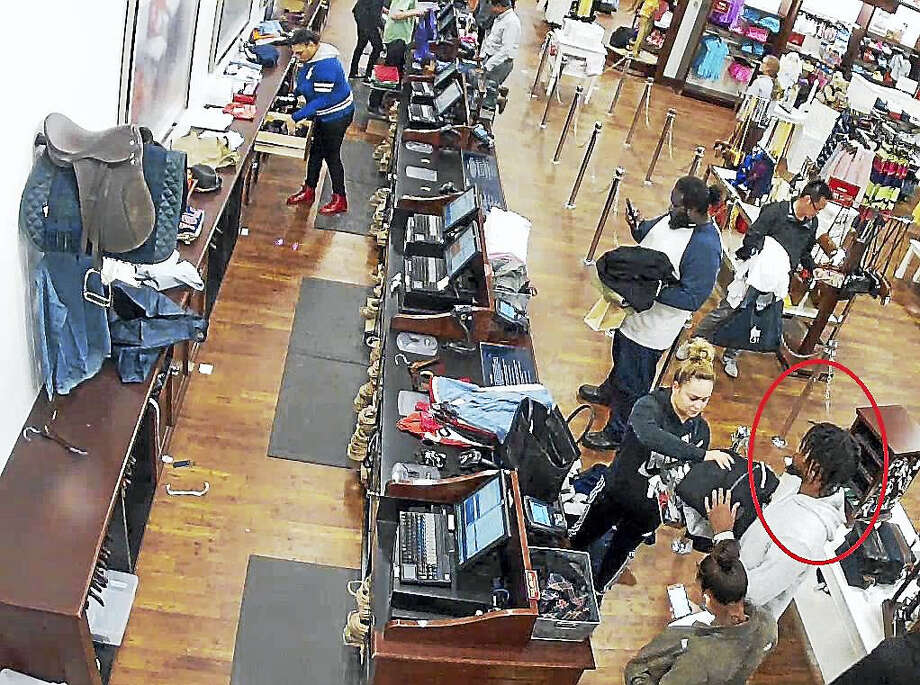 Photo courtesy of the Clinton Police DepartmentClinton Police are asking the public to help them track down four to five suspects who allegedly worked together to steal $11,000 worth of merchandise from the POLO store at the Clinton Crossing Premium Outlets between January and March. Photo: Journal Register Co.