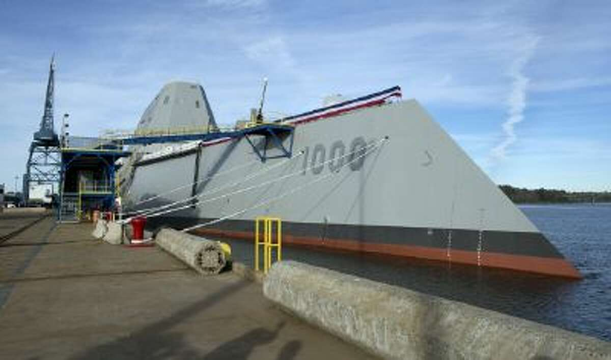 In a Thursday, Oct. 31, 2013 file photo, the Navy's stealthy Zumwalt destroyer is moored at Bath Iron Works, in Bath, Maine.