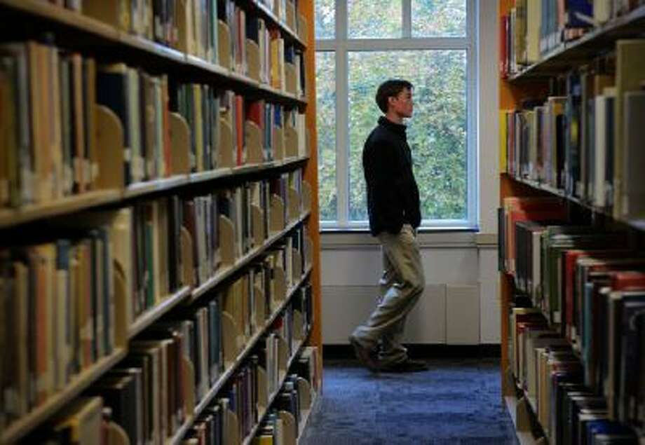 High-school senior Mike Dorsch, of Howard County, Md., strolls through the library of St. Mary's College of Maryland while touring the campus on Nov. 1, 2013 in St. Mary's Md.