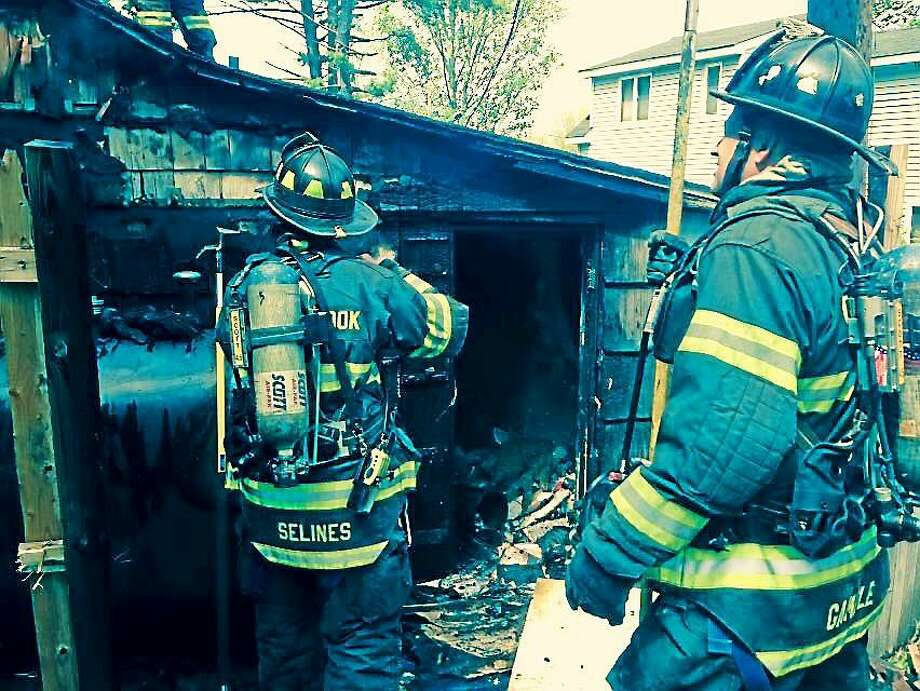 (Photo courtesy of the Old Saybrook Fire Department) Two people were displaced from their home on Hill Street in Old Saybrook after a fire Monday afternoon. No one was injured in the incident. Photo: Journal Register Co.