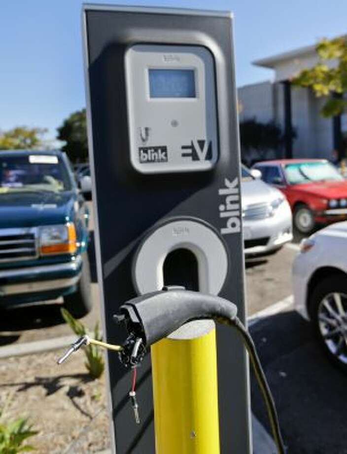 The cord at a electric vehicle charging station is damaged and unusable at a mall Nov. 13, 2013, in San Diego. The station had four charging units including one in a handicap parking area.