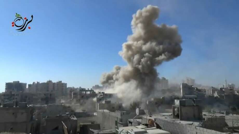 This image made from citizen journalist video posted by the Shaam News network, which is consistent with AP reporting, shows shelling in the Barzeh area of Damascus, Syria Tuesday, Sept. 17, 2013. Moscow insisted on Tuesday that a new Security Council resolution on Syria not allow the use of force, while the Arab country's main opposition group demanded a swift international response following the U.N. report that confirmed chemical weapons were used outside Damascus last month.(AP Photo/Shaam News Network via AP video) Photo: AP / Shaam News Network