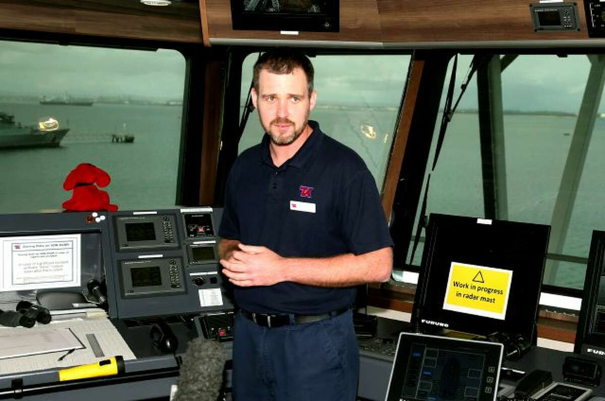 Master of the Ocean Shield Captain Nicholas Woods speaks about the roll his ship will play in the search for missing Malaysia Airlines Flight MH370 in Perth, Australia, Sunday, March 30, 2014. An Australian warship with an aircraft black box detector was set to depart Sunday to join the search. It will still take three to four days for the ship, the Ocean Shield, to reach the search zone - an area roughly the size of Poland about 1,850 kilometers (1,150 miles) to the west of Australia....