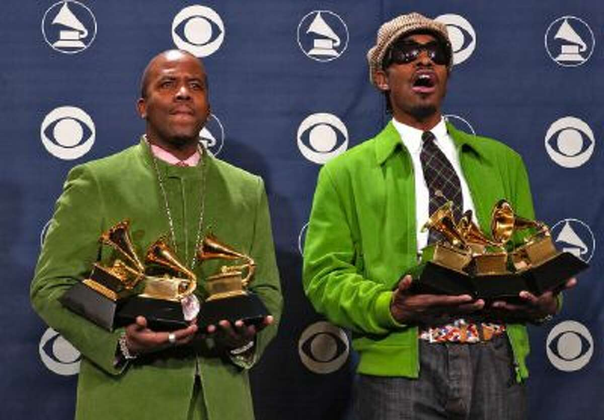 OutKast members Big Boi, left, and Andre 3000 pose with the three awards they won at the 46th Annual Grammy Awards, Sunday, Feb. 8, 2004, in Los Angeles. The duo is reuniting for Coachella.