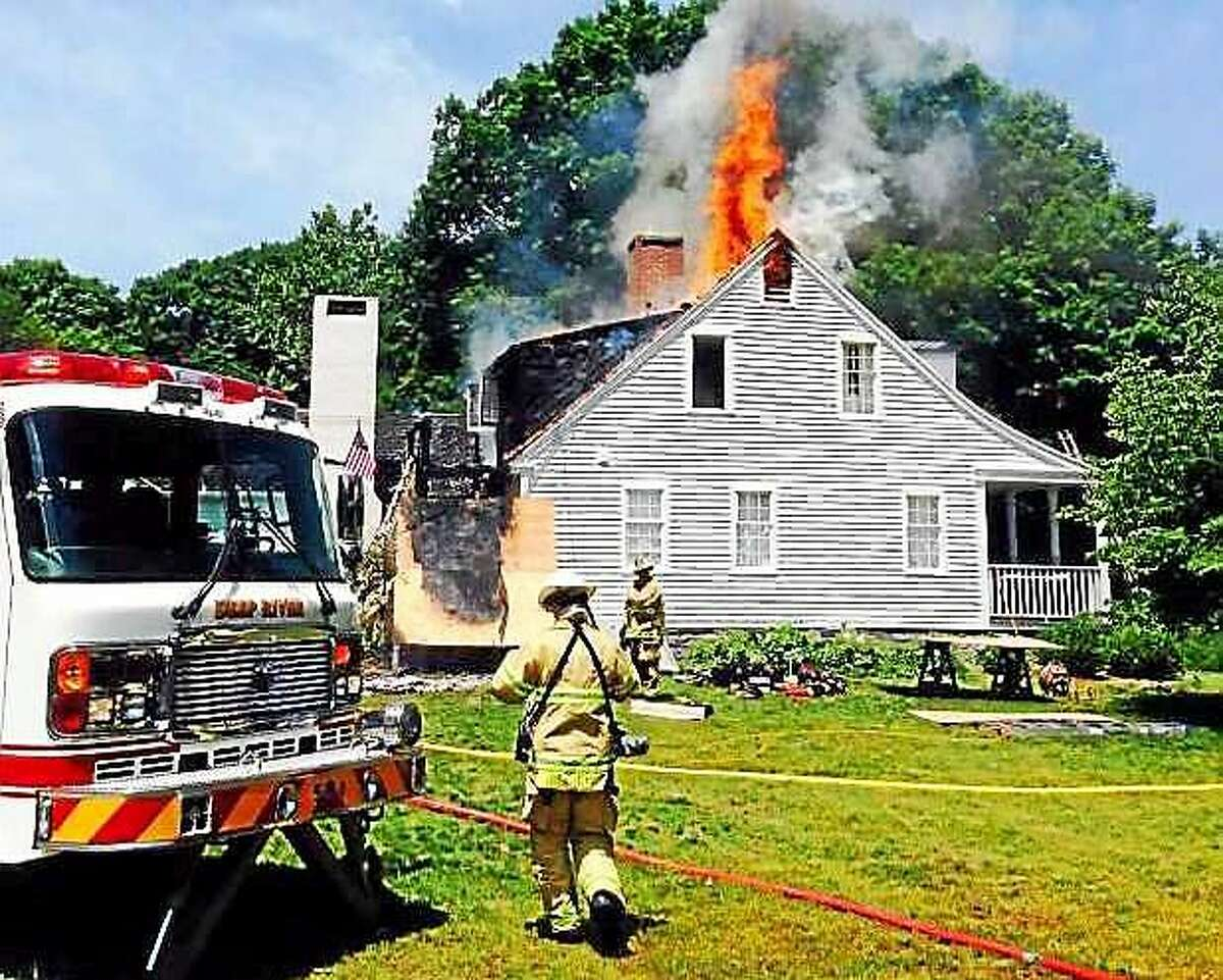 (Photos via the Deep River Fire Department) Crews from Deep River, Essex, Chester, Westbrook and Old Saybrook battled a house fire Thursday at 83 River Road in Deep River. Officials said the fire started in a truck parked near the house.