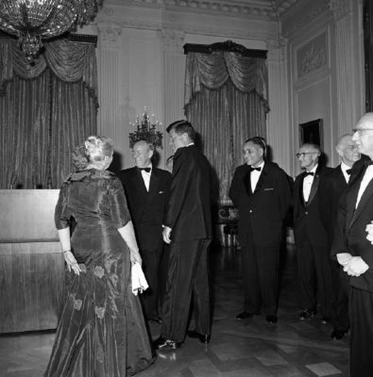 President John F. Kennedy and Lester Pearson, leader of Canada's Liberal Party and winner of the 1957 Nobel Peace Prize, talk at the White House, Washington, April 29, 1962 with Pearl Buck, back to camera, and Pearson's wife Maryon, before a White House dinner honoring Nobel Prize winner of the western Hemisphere.