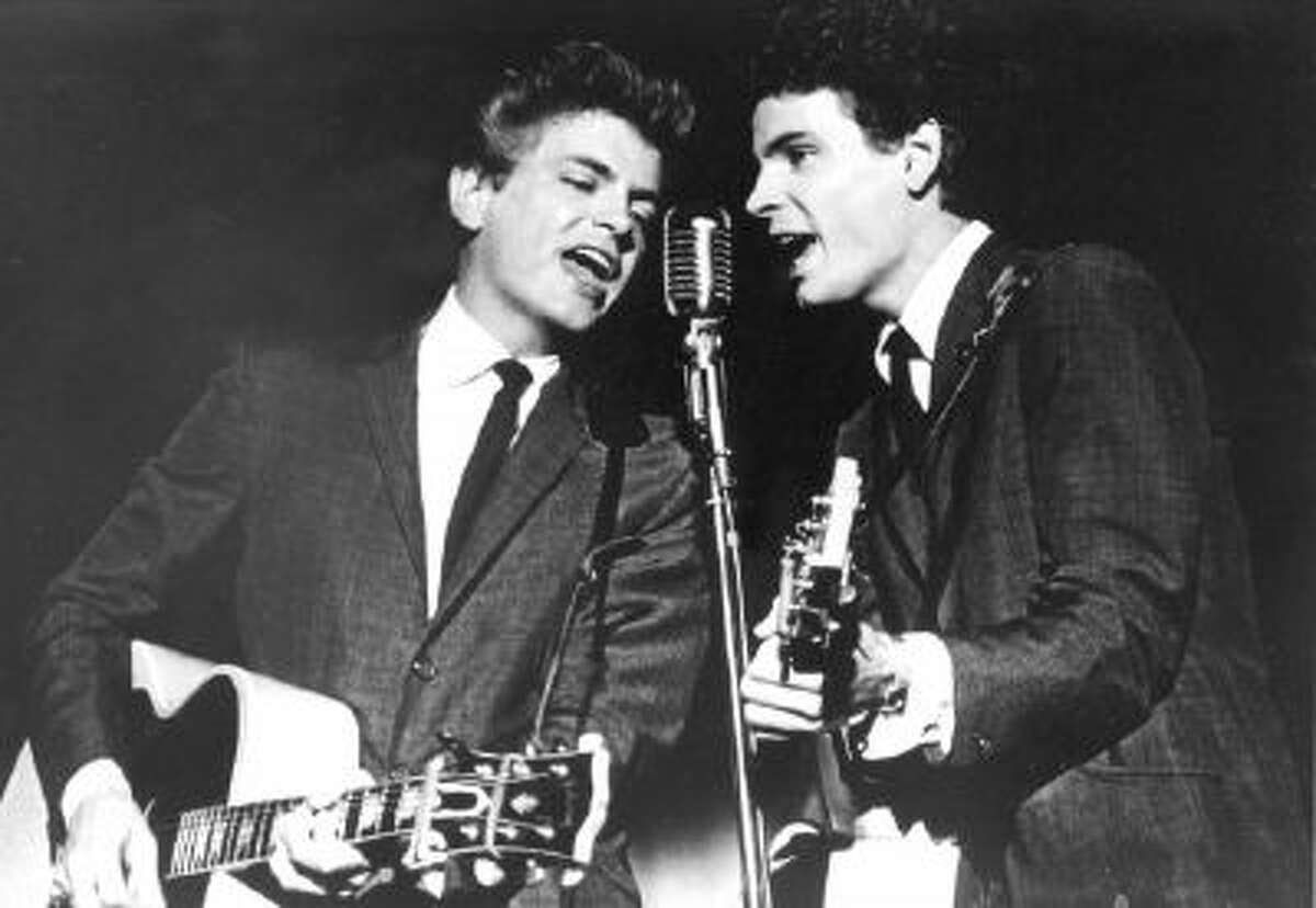 This July 31, 1964 file photo shows The Everly Brothers, Don and Phil, performing on stage. Everly, who with his brother Don formed an influential harmony duo that touched the hearts and sparked the imaginations of rock 'n' roll singers for decades, including the Beatles and Bob Dylan, died Friday, Jan. 3, 2014.