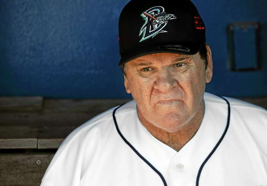Pete Rose sits in the dugout at The Ballpark at Harbor Yard, Monday, June 16, 2014, in Bridgeport, Conn. Rose, banned from Major League Baseball, returned to the dugout for one day to manage the independent minor-league Bridgeport Bluefish. (AP Photo/Jessica Hill) Photo: AP / FR125654 AP
