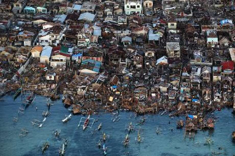 An aerial view of a demolished coastal town on Eastern Samar Island in Leyte, Philippines. Typhoon Haiyan, which ripped through Philippines over the weekend, has been described as one of the most powerful typhoons ever to hit land, leaving thousands dead and hundreds of thousands homeless. Photo: Getty Images / 2013 Getty Images
