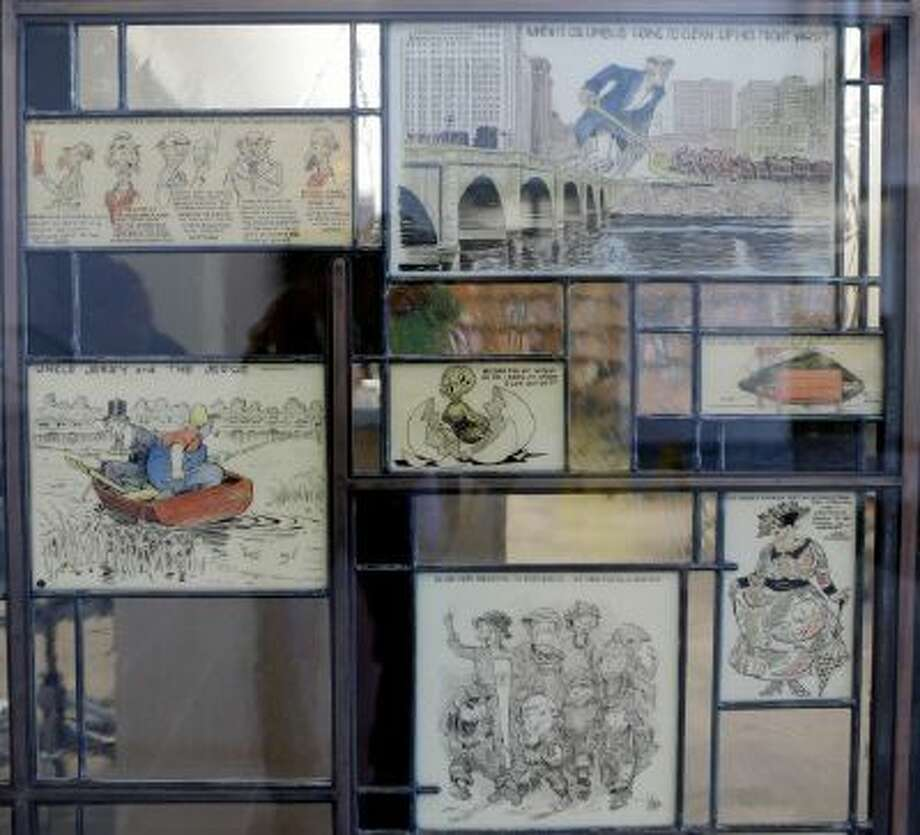"""This Wednesday, Oct. 23, 2013 photo shows stained glass pieces from """"The Passing Show"""" at the Billy Ireland Cartoon Library & Museum in Columbus, Ohio."""