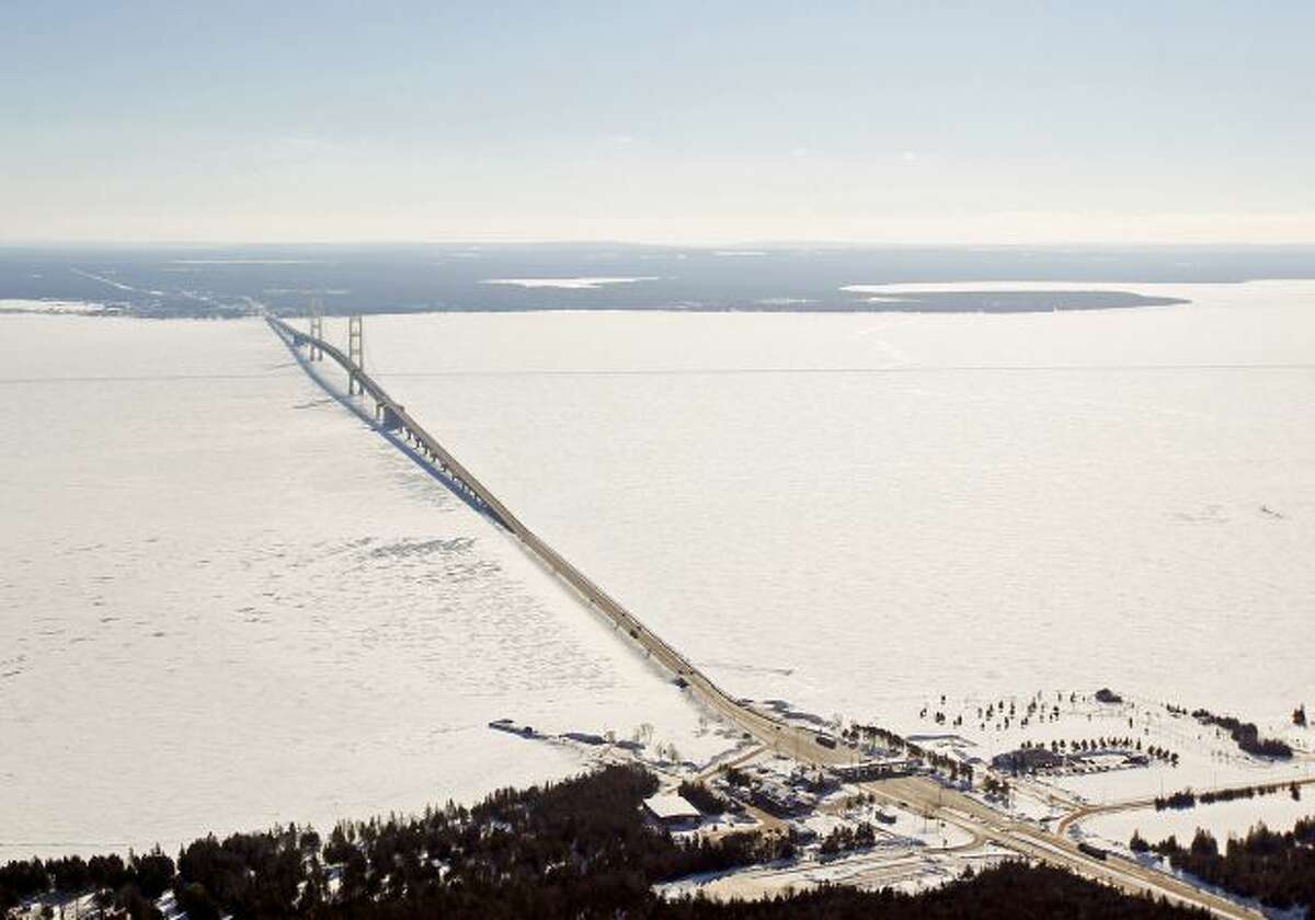 In this Feb. 11, 2014 aerial photo is a view of The Mackinac Bridge which spans a 5-mile-wide freshwater channel that separates Michigan's upper and lower peninsulas. The straits is drawing the attention of some who consider the twin 20-inch pipes that stretch across the bottom of the waterway, carrying nearly 23 million gallons of crude oil daily, a symbol of the dangers lurking in the nation's sprawling web of buried oil and natural gas pipelines. (AP Photo/ Traverse City...