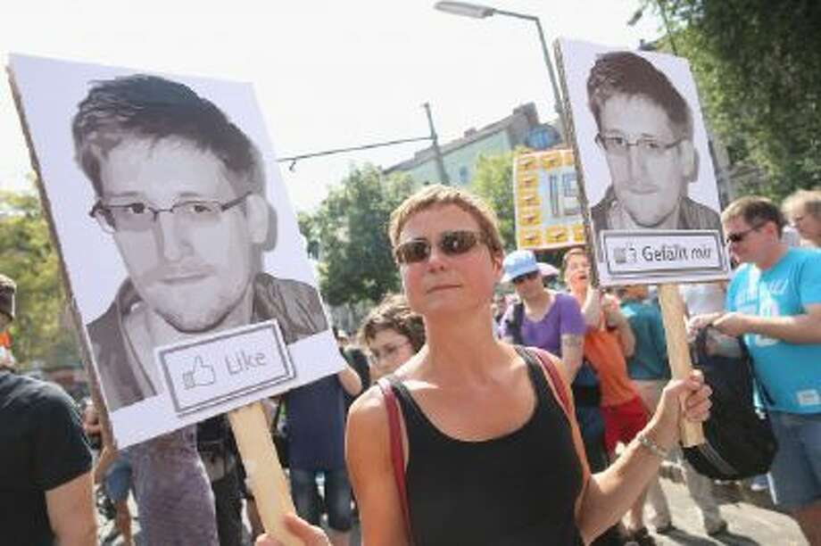 A participant demonstrates in support of former NSA employee Edward Snowden at a protest march against the electonic surveillance tactics of the NSA on July 27, 2013 in Berlin, Germany.