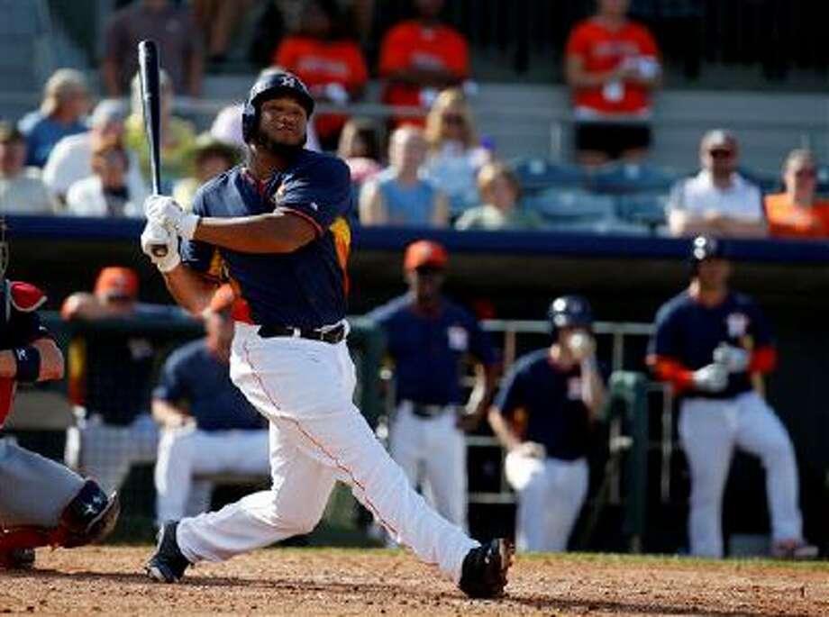 Houston Astros first baseman Jon Singleton (13) bats in a spring exhibition baseball game against the Atlanta Braves, Sunday, March 2, 2014, in Kissimmee, Fla. The Astros won 7-4. (AP Photo/Alex Brandon) Photo: AP / AP