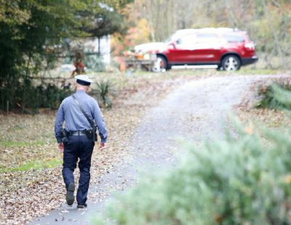 A Pennsville police officer walks up the driveway to the Ciancia home.