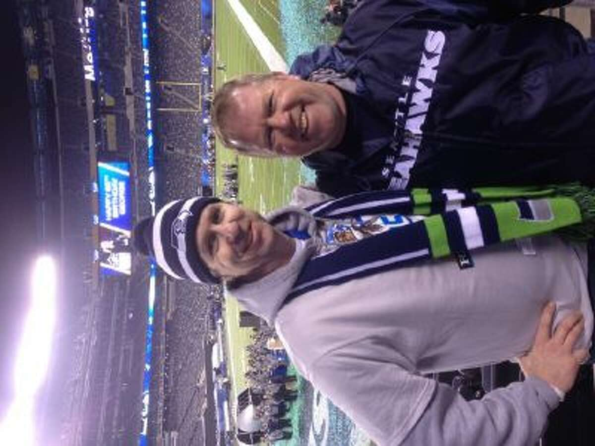 Tom Gish and Mike O'Donnell pose in front of the field at MetLife Stadium after Super Bowl XLVIII.