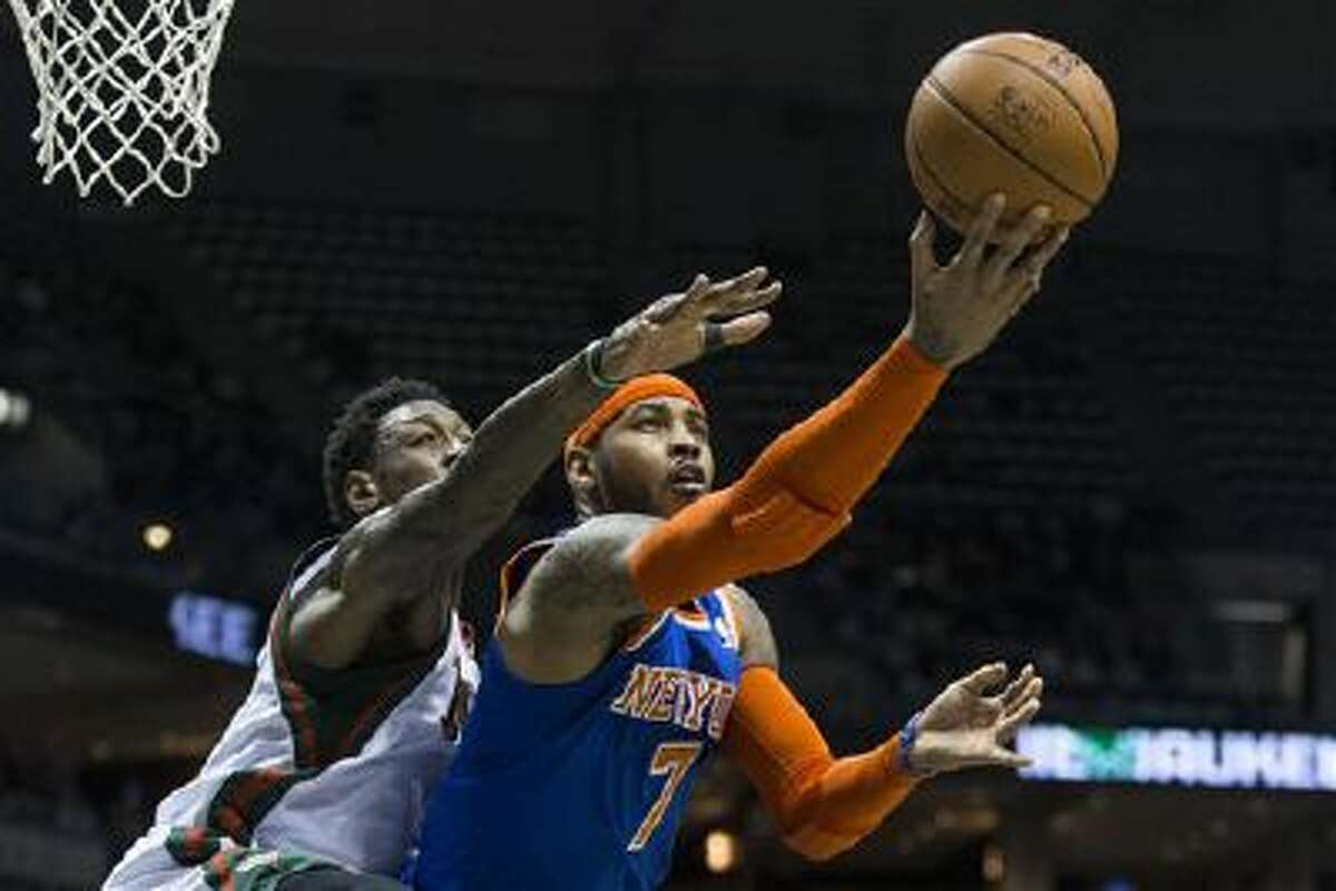 New York Knicks' Carmelo Anthony shoots the ball against Milwaukee Bucks' Larry Sanders during the first half of an NBA basketball game, Monday, Feb. 3, 2014, in Milwaukee. (AP Photo/Tom Lynn)