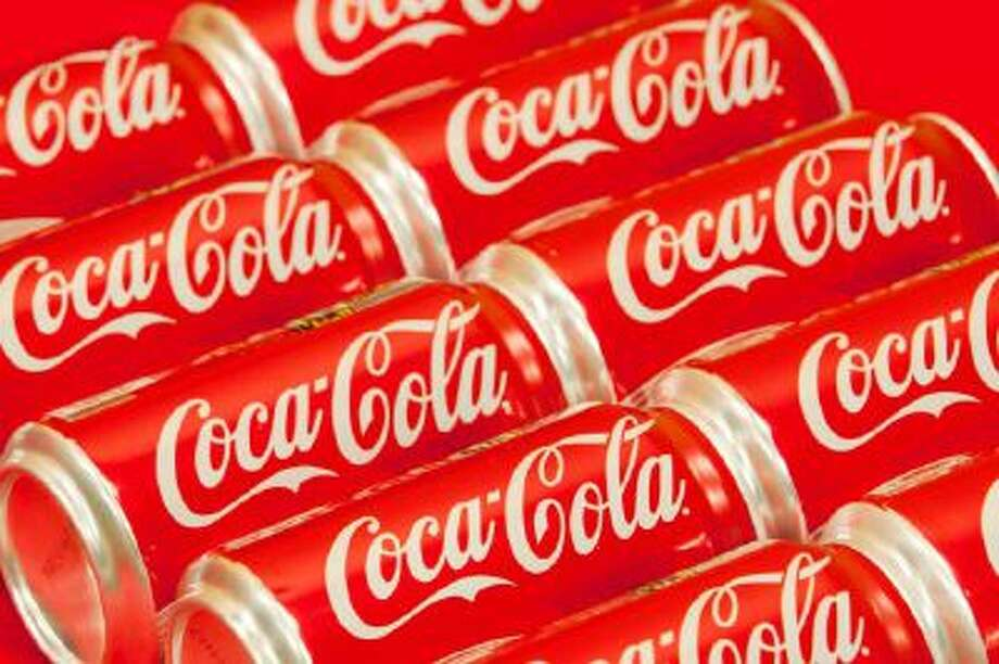 Cans of Coca-Cola are shown.