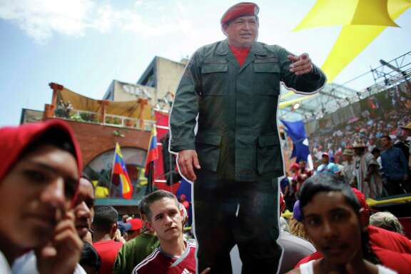 A cutout of Venezuela's late President Hugo Chavez stands out among supporters during a rally backing the new Constitutional Assembly outside the National Assembly building in Caracas, Venezuela, on Monday.