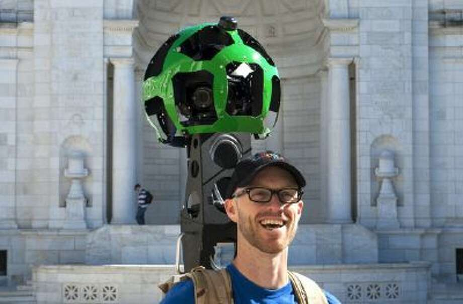 Patrick Fennie pauses for a photograph as he captures the scene at Memorial Amphitheater at Arlington National Cemetery in Virginia for Google Maps Street View on Sunday Oct. 20, 2013. The images will be stitched together and released in May, allowing people to virtually visit the cemetery on their computers.