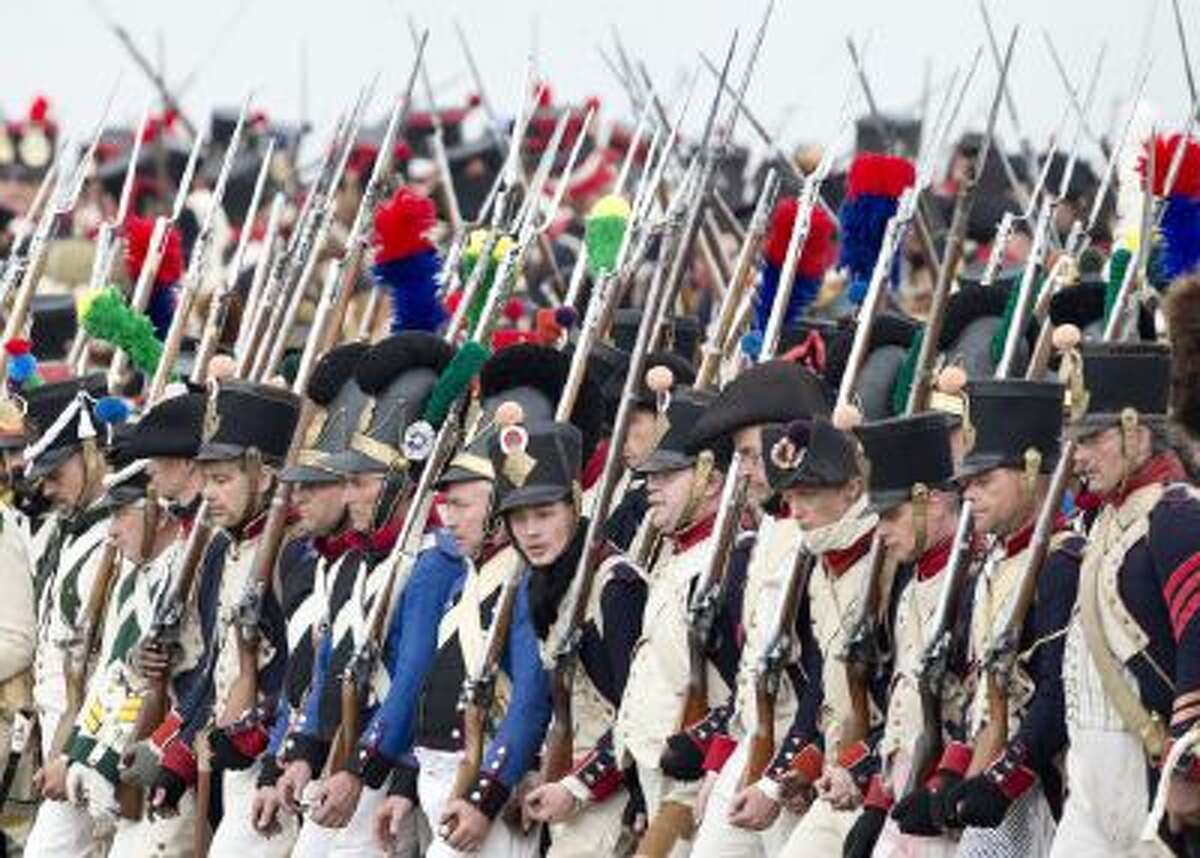 Troops march during the reconstruction of the Battle of the Nations at the 200th anniversary near Leipzig, central Germany, Sunday, Oct. 20, 2013.