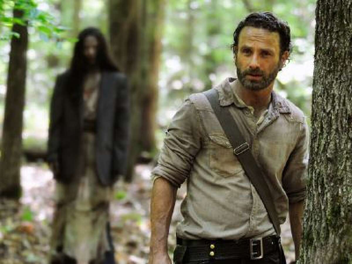"""This image released by AMC shows Andrew Lincoln as Rick Grimes in a scene from the season four premiere of """"The Walking Dead,"""" airing Oct. 13 at 9 p.m. EST."""