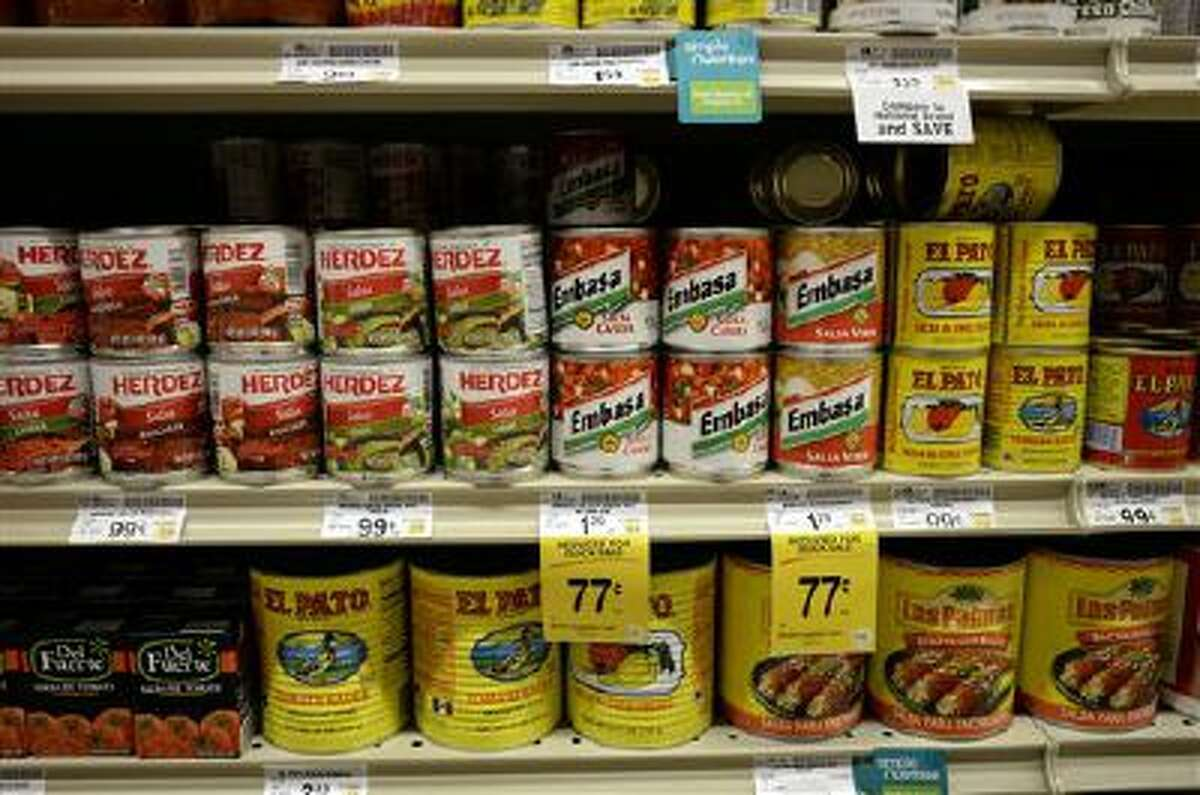 Salsas and other items are seen in the International food aisle of a grocery store Wednesday, Oct. 16, 2013 in Washington.