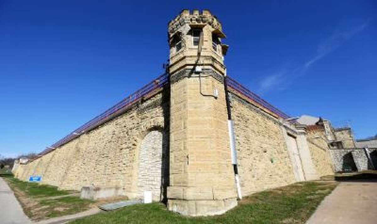 This Monday, Nov. 18, 2013, photo shows a guard tower at the Iowa State Penitentiary in Fort Madison, Iowa.