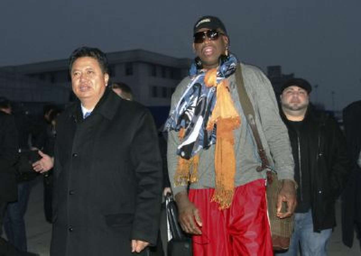 Dennis Rodman walks with Vice Minister of North Korea's Sports Ministry, Son Kwang Ho, as Rodman arrives at the international airport in Pyongyang, North Korea.