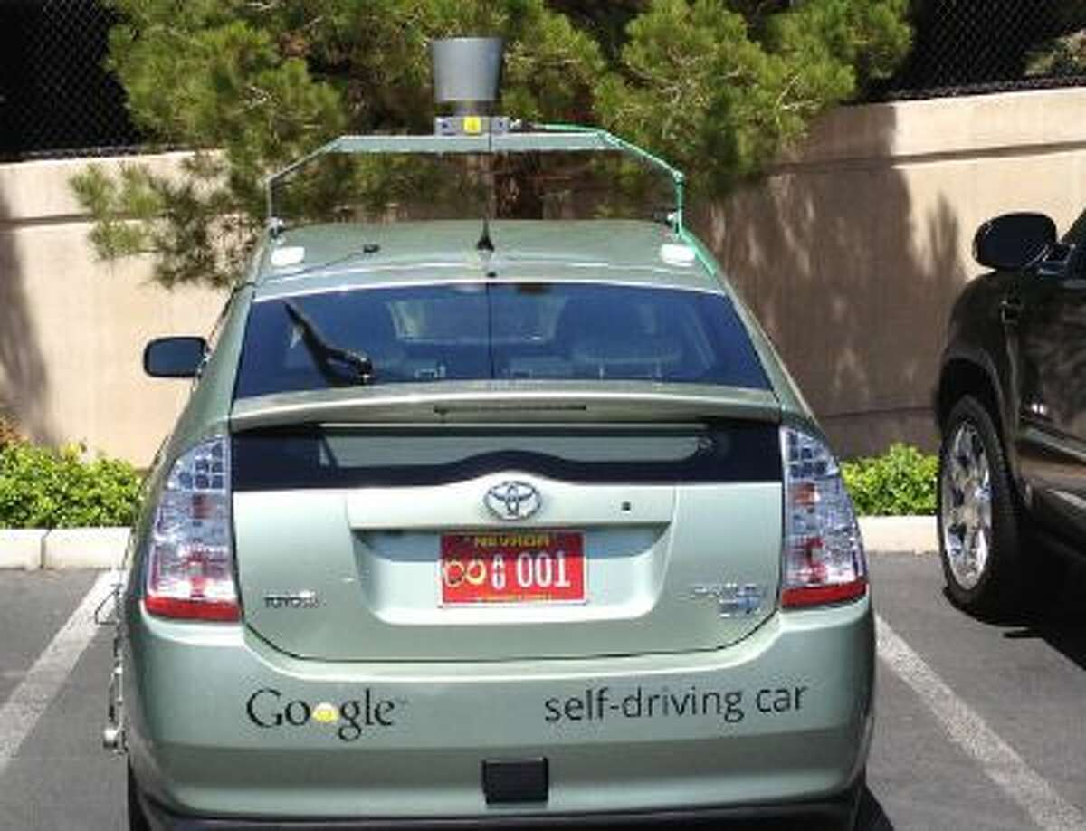 The first officially licensed Google self-driving car, a Toyota Prius hybrid.
