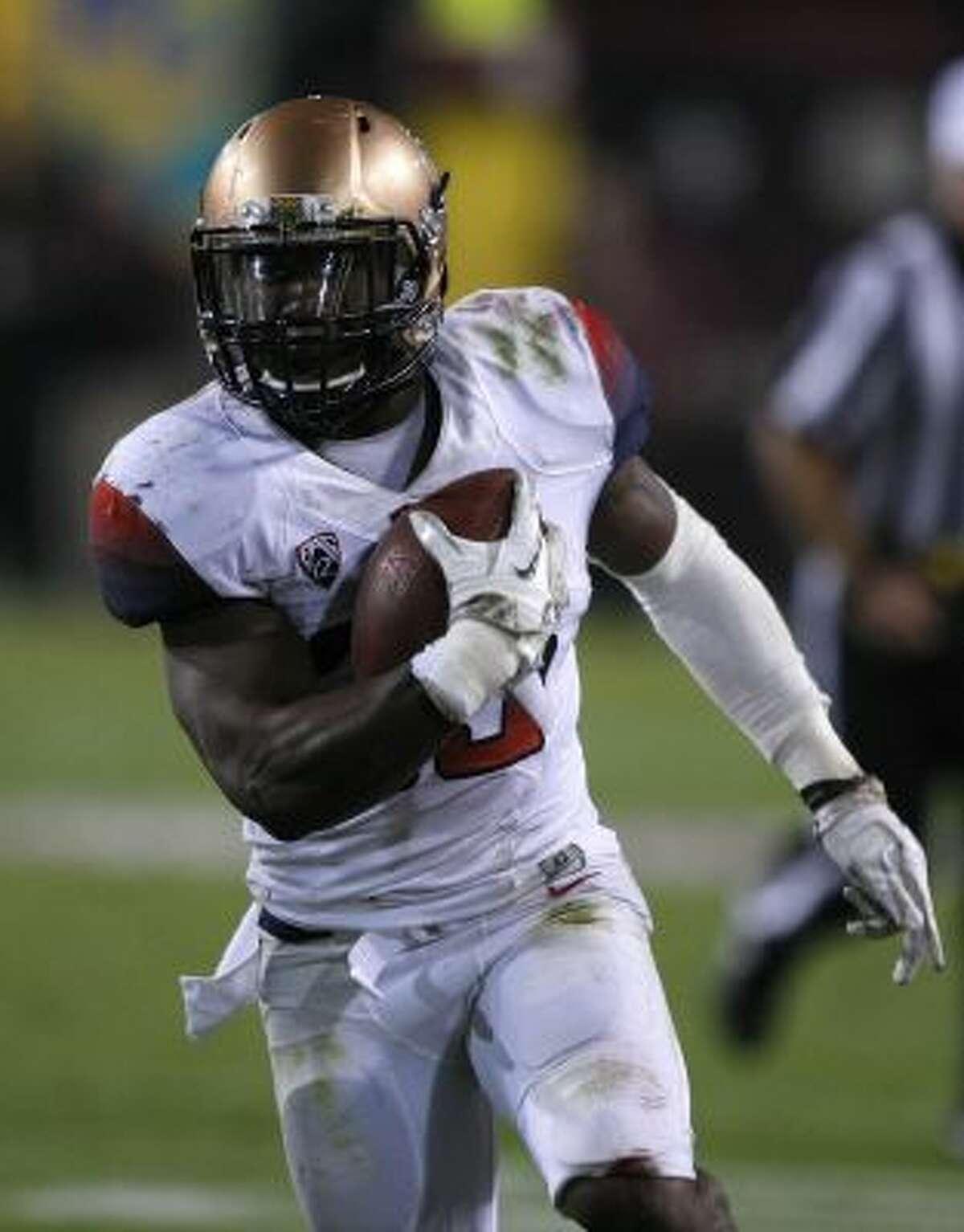 Arizona running back Ka'Deem Carey (25) rushed for 1,716 yards and 17 touchdowns this season.