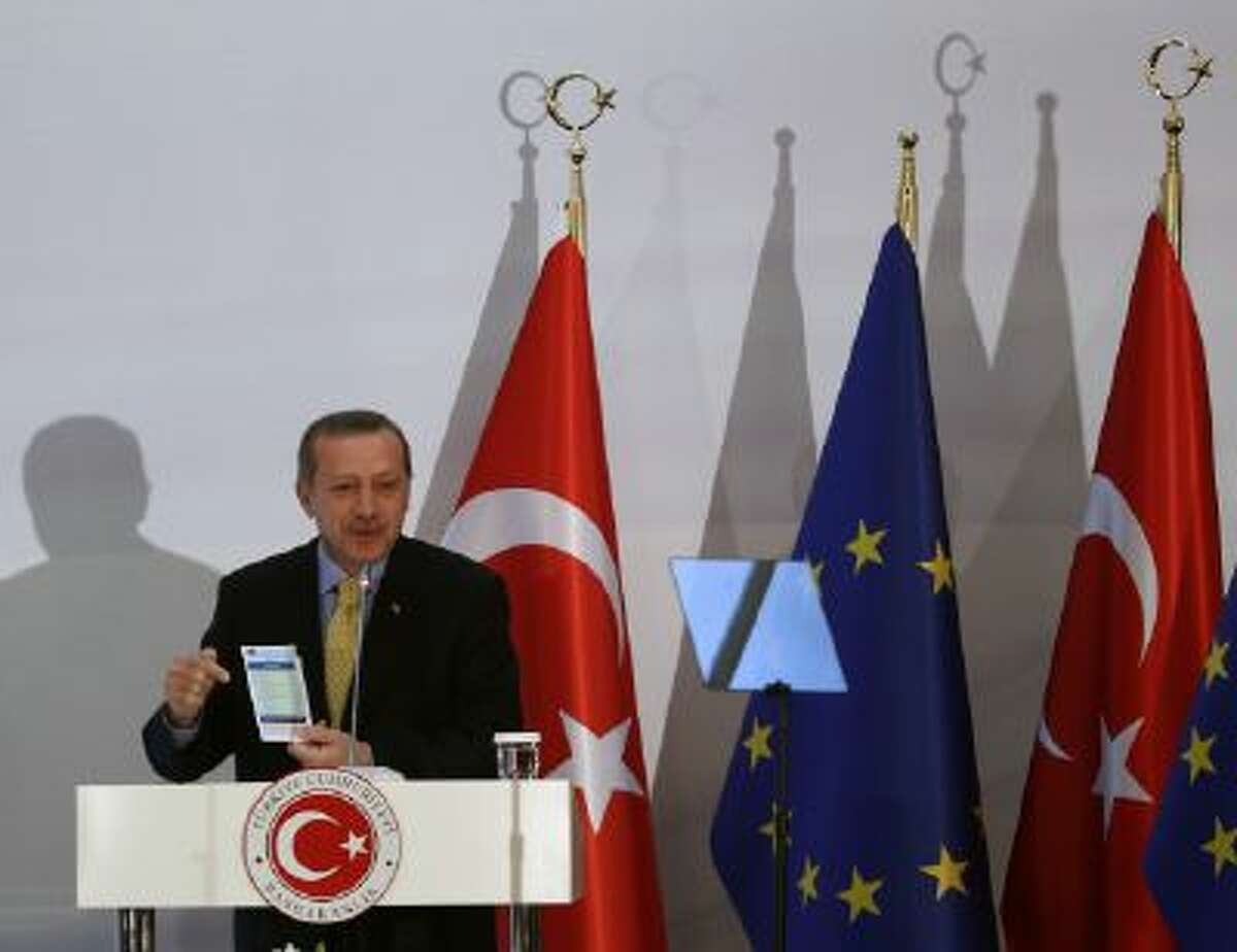 Turkish Prime Minister Recep Tayyip Erdogan speaks after the EU and Turkey signed agreements in Ankara, Turkey, Monday, Dec. 16, 2013.
